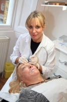 Debra treating Kellie Maloney in our Harley Street Clinic